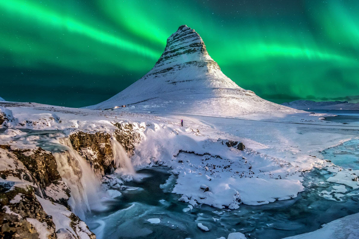 Kirkjufell at winter time with Northern Lights