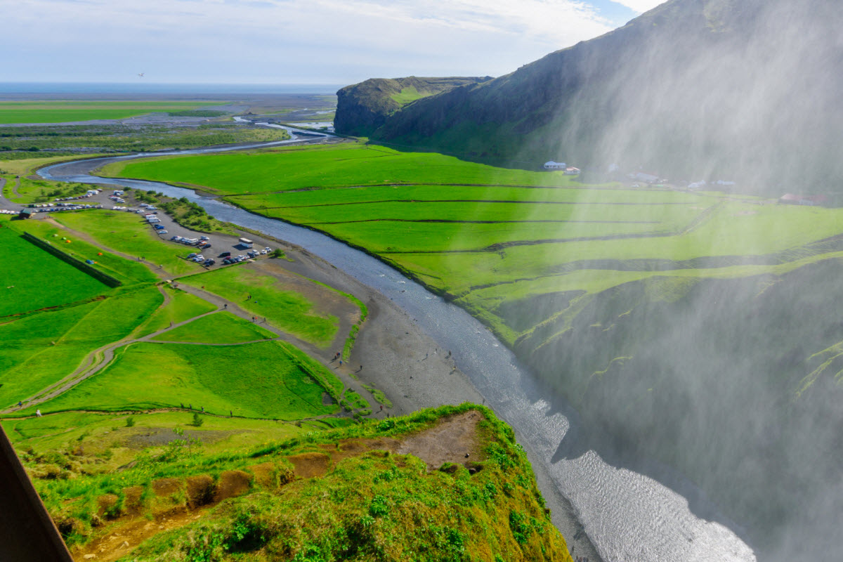 The view from the top of Skógarfoss waterfall and the beginning of the popular hike Fimmvörðuháls