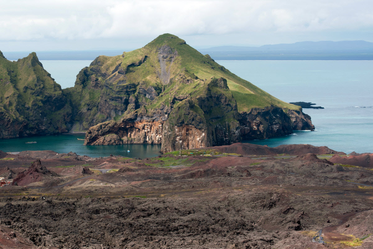 Multi colored lava landscape can be found in Vestmannaeyjar island