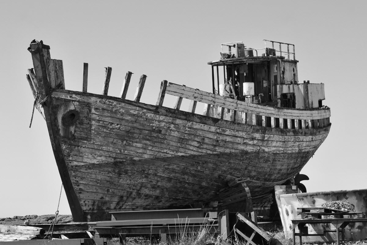 Old rusty wooden shipwreck in Akranes Iceland