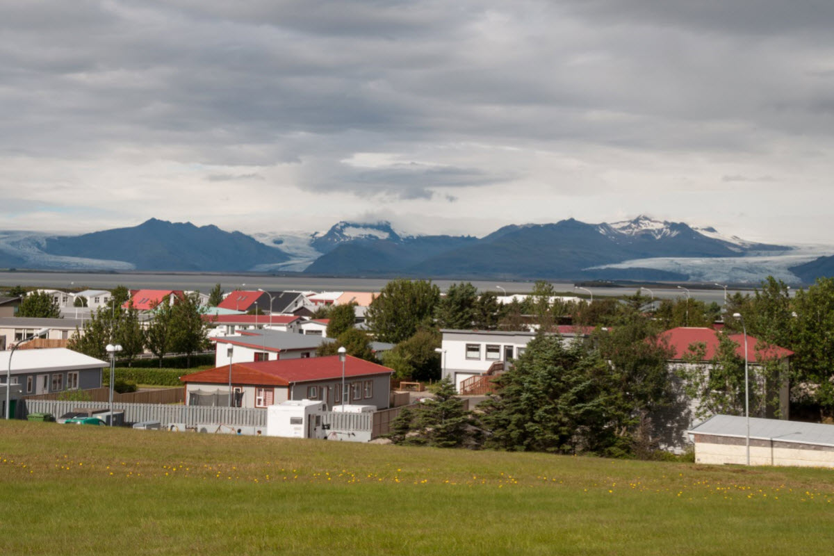 The town Höfn in southern Iceland with glaciers in the background