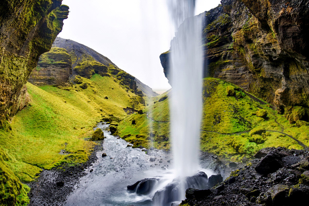 It is possible to hike behind Kvernufoss waterfall