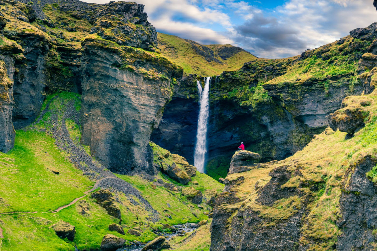 Kvernufoss waterfall is located in Kvernugil a gorge with picturesque hyaloclastite and basalt formations