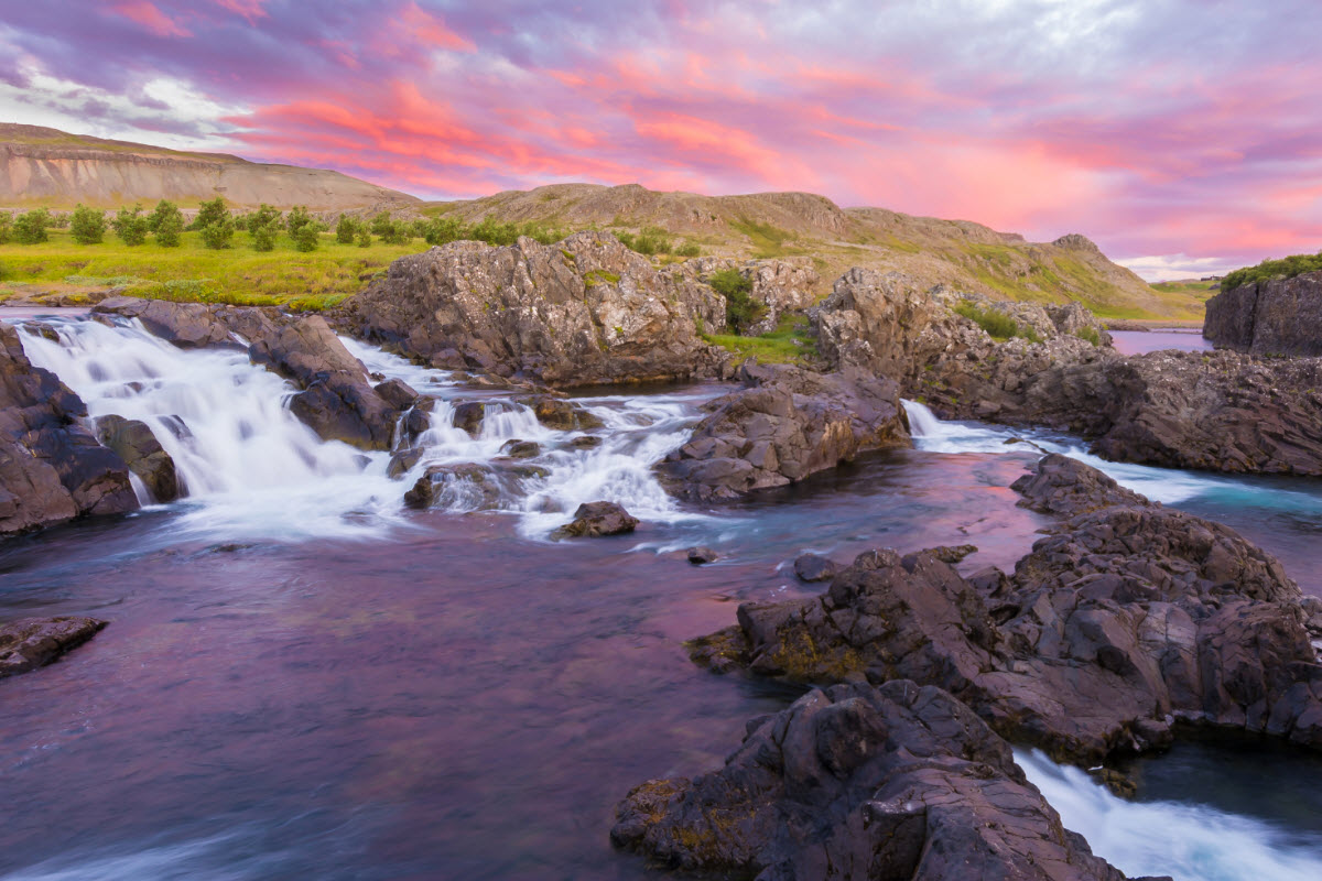 Sunset by the waterfall Glanni in west Iceland