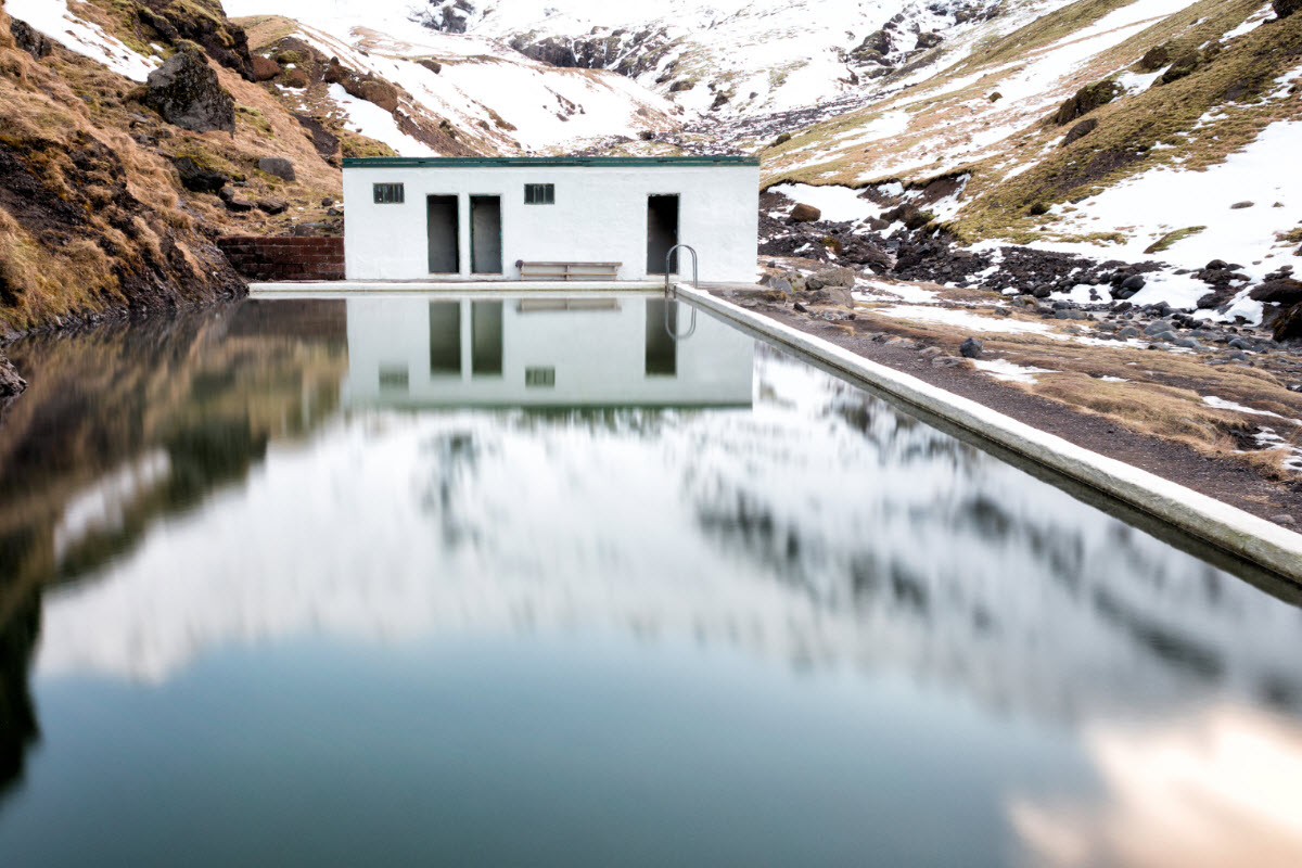Seljavallalaug natural swimming pool during winter in South Iceland