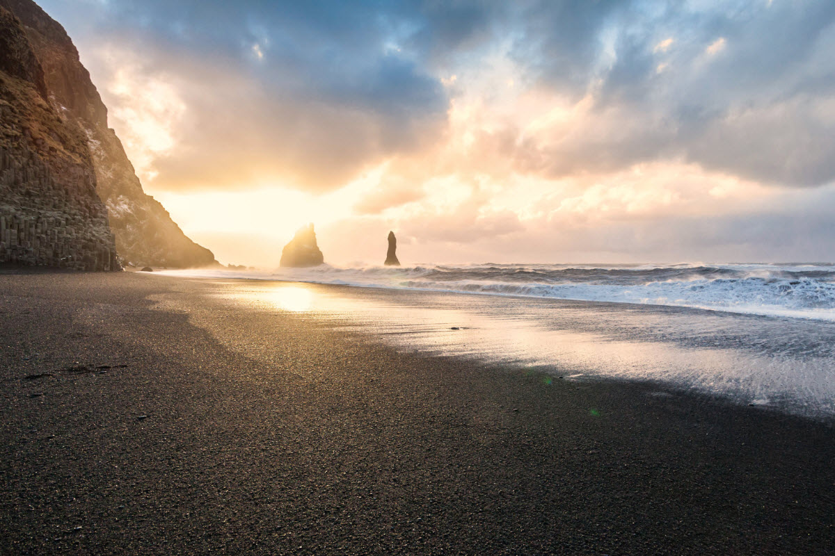 Sunset At Reynisfjara Black Sand Beach In South Iceland