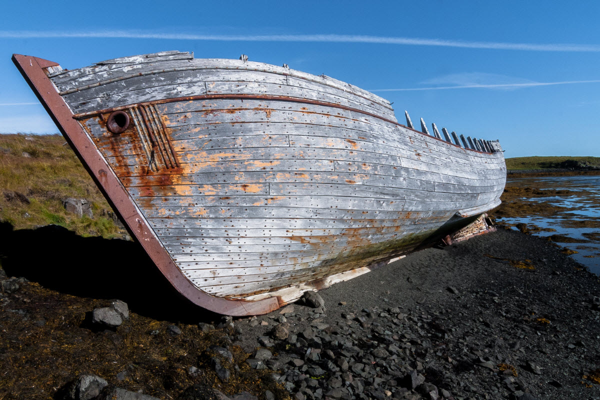 Wreck of fishing boat in Flatey island